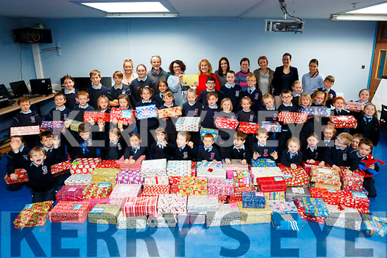 "Pupils of Ardfert NS present their 130 Christmas Shoe Boxes ro Team ""Hope"" for Children in Eastern Europe and Africa"