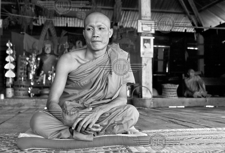 Ill with AIDS, Bhuddist monk Khana Sihachakh (25) sits in a monastery in Vientiane, Laos on October 19, 2000. His wife died of AIDS in 1998, and Khana became a monk in order to try and help others with the the disease. Worldwide, more than 20 million people have died since the first cases of AIDS were identified in 1981.