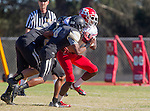 Palos Verdes, CA 10/24/14 - Dallas Branch (Redondo Union #7) and Sam Sayegh (Peninsula #55)in action during the Redondo Union - Palos Verdes Peninsula CIF Varsity football game at Peninsula High School.