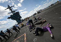 111006-N-DR144-443 PACIFIC OCEAN (Oct. 6, 2011) Simulated casualties await evacuation and medical treatment during a mass casualties drill on the flight deck aboard Nimitz-class aircraft carrier USS Carl Vinson (CVN 70). The Carl Vinson Strike Group is underway conducting operations off the coast of Southern California.  U.S. Navy photo by Mass Communication Specialist 2nd Class James R. Evans (RELEASED).