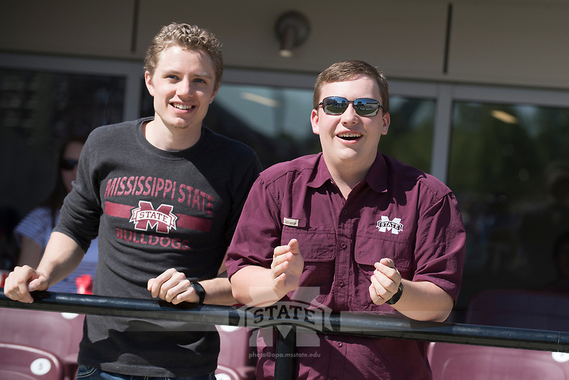 Fans cheering at the Maroon and White spring football game<br />  (photo by Beth Wynn / &copy; Mississippi State University)