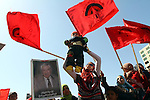 A Palestinian supporter of the Democratic Front for the Liberation of Palestine (DFLP) hold her baby during a rally celebrating 42 years since its founding in Gaza City, Saturday, Feb. 26, 2011. Founded in 1969 the DFLP is a Palestinian Marxist-Leninist, secular political and military organization. Photo by Ashraf Amra