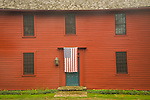Historic home with front door American flag. Madison, CT.