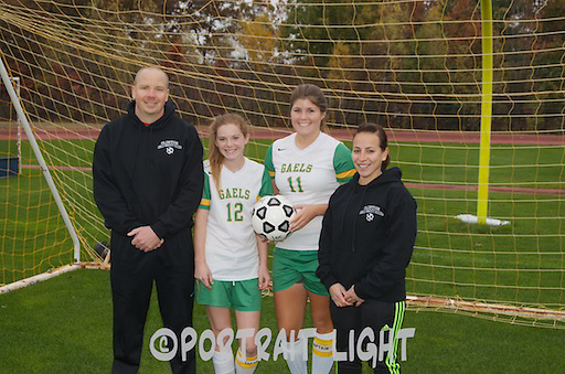 CHS senior captains Rachel McGown (center left) and Alexis Dylewicz with head coach Yanina Fusano and volunteer assistant coach Greg Burns.