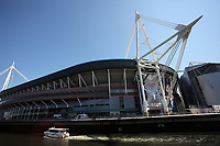 Pictured: A small cruise boat travels in river Taff as workers in abseiling gear install a banner outside the National Stadium of Wales (aka Principality Stadium) Thursday 25 May 2017<br />Re: Preparations for the UEFA Champions League final, between Real Madrid and Juventus in Cardiff, Wales, UK.