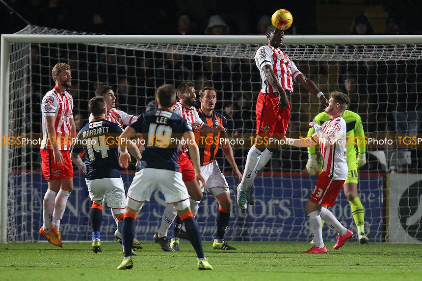 Armand Gnanduillet of Stevenage heads clear during Stevenage vs Luton Town, Sky Bet League 2 Football at the Lamex Stadium, Stevenage, England on 21/11/2015