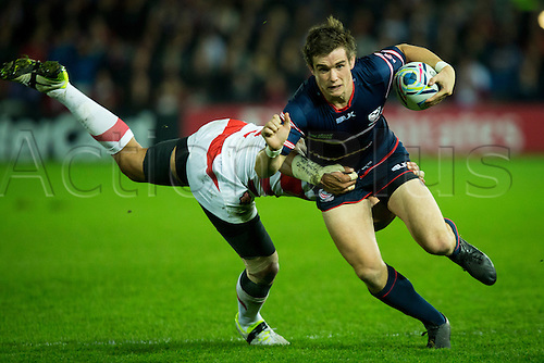 11.10.2015. Kingsholm Stadium, Gloucester, England. Rugby World Cup. USA versus Japan. AJ McGinty of USA tries to break free of a tackle.
