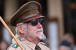 Korean War Army veteran Geno Oliver marches in the Veteran's Day Parade in Virginia City, Nev., on Tuesday, Nov. 11, 2014.<br /> Photo by Cathleen Allison