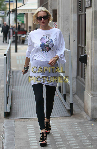 Denise Van Outen .At BBC Radio 1 studios, .London, England, UK, 9th June 2011..full length  white cropped top t-shirt grey gray black wedges leggings sunglasses   suitcase walking .CAP/HIL.©John Hillcoat/Capital Pictures.