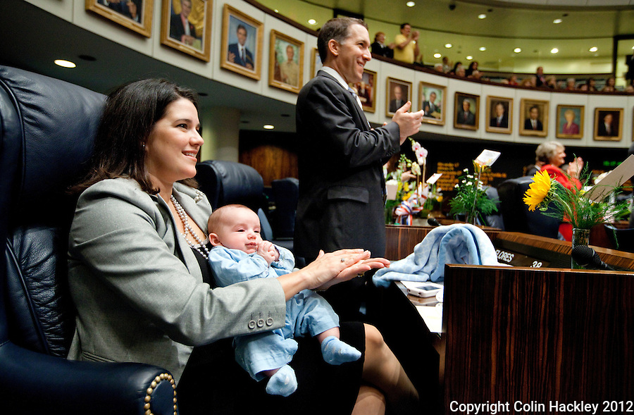 TALLAHASSEE, FLA. 1/10/12-OPENING011012 CH-Sen. Anitere Flores, R-Miami, holds her son Lucas Ignacio Anderson, age 2 1/2 months, during the opening day of the 2012 legislative session at the Capitol in Tallahassee..COLIN HACKLEY PHOTO