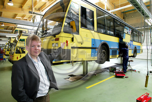 BRUSSELS - BELGIUM - 04 MAY 2005 --Jari PELTOLA inspects one of 130 Van Hool A500 busses at The Brussels Local Transport Co (STIB) for sale  on internet. They are manufactured in 1991 - 1992 by .-- PHOTO: ERIK LUNTANG / EUP-IMAGES..