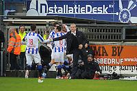 VOETBAL: HEERENVEEN: Abe Lenstra Stadion, 09-12-2012, Eredivisie 2012-2013, SC Heerenveen - Roda JC, Eindstand 4-4, Lukas Marecek (SCH), Sven Kums (SCH) en Marten de Roon (SCH) feliciteren Rajiv van La Parra na de 2-1, Henk Herder (assistent-trainer), Marco van Basten (trainer/coach) krabbelt weer op van de grond, ©foto Martin de Jong