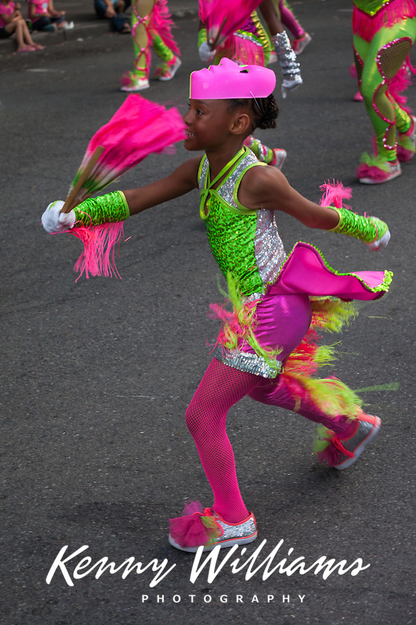 Cute girl in pink and green dancing, Chinatown Seafair Parade 2015, Seattle, Washington State, WA, America, USA.