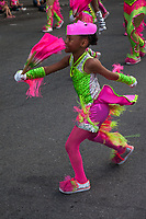 Cute girl in pink and green dancing, Chinatown Seafair Parade 2015, Seattle, Washington State, WA, America, USA.