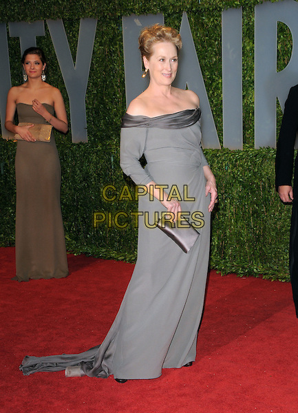 MERYL STREEP.The 2009 Vanity Fair Oscar Party held at The Sunset Tower Hotel in West Hollywood, California, USA..February 22nd, 2009.oscars full length long maxi dress grey gray off the shoulder clutch bag.CAP/DVS.©Debbie VanStory/Capital Pictures.