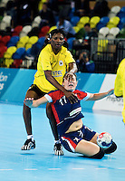 23 NOV 2011 - LONDON, GBR - Britain's Ewa Palies (#17, in blue and red) finds herself challenged by Angola's Luisa Kiala (in yellow and black) during the 2011 London Handball Cup match at The Handball Arena in the Olympic Park in Stratford, London .(PHOTO (C) NIGEL FARROW)