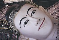 The head of the enormous reclining Shwethalyaung Buddha in Pegu (Bago). This statue is revered throughout Burma as the country's most beautiful reclining Buddha and is thought to depict Gautama on the eve of his entering nirvana.