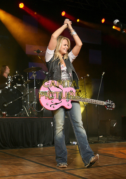 MIRANDA LAMBERT.The Academy of Country Music presents its fourth annual New Artists Show   featuring performances by Top New Artist' nominees held at the MGM Grand Ballroom in the MGM Grand Convention Center, Las Vegas, Nevada, USA,.14 May 2007 ..Full length concert gig live on stage black waistcoat jeans pink guitar hands up together above head.CAP/ADM/BP.©Byron Purvis/AdMedia/Capital Pictures.