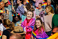 Pictured: Two young women, part of the Pride parade which traveled through the streets of Swansea, Wales, UK. Saturday 05 May 2018<br /> Re: Spring Pride has brought a celebration of colour to the streets of Swansea in Wales, UK.<br /> Rainbow flags were flown in support of the LGBT community at the event, which is designed to raise awareness and is open to anyone to take part in.
