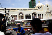 Pedestrians seen outside the Quiapo Church, also known as Minor Basilica of the Black Nazarene in Quiapo, Manila, in the Philippines. Photo: Sanjit Das