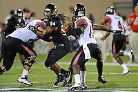 24 September 2011:  FIU defensive lineman James Jones (94) rushes ULL quarterback Blaine Gautier (17) in the third quarter as the University of Louisiana-Lafayette Ragin Cajuns defeated the FIU Golden Panthers, 36-31, at FIU Stadium in Miami, Florida.