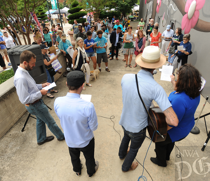 NWA Democrat-Gazette/ANDY SHUPE<br /> Saturday, June 17, 2017, during the Don't Deport Dad! rally in front of the Fayetteville Towncenter. Ozark Indivisible and the Arkansas Justice Collective partnered to organize the rally to pressure the Washington County Sheriff's Office to end its efforts to assist Federal agencies in the deportation of residents.