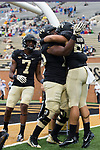 Cam Serigne (right) gets a hug from teammate Justin Herron (75) after scoring a touchdown during first quarter action against the Presbyterian Blue Hose at BB&T Field on August 31, 2017 in Winston-Salem, North Carolina.  The Demon Deacons defeated the Blue Hose 51-7.  (Brian Westerholt/Sports On Film)