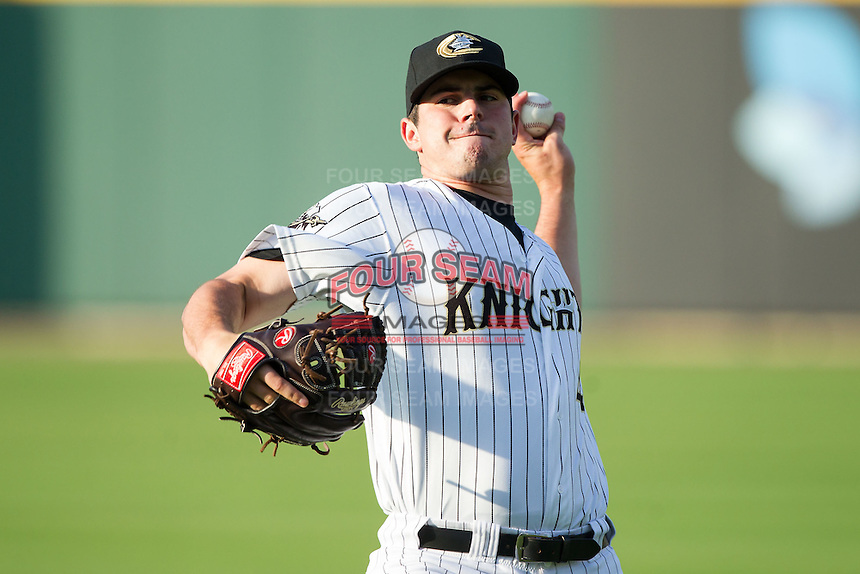 Charlotte Knights starting pitcher Carlos Rodon (41) warms up in the outfield prior to the game against the Gwinnett Braves at BB&T Ballpark on August 19, 2014 in Charlotte, North Carolina.  The Braves defeated the Knights 10-5.   (Brian Westerholt/Four Seam Images)