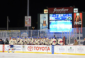 Rochester Amerks defensemen Drew Bagnall (4) goes down the bench after a goal during the third period of The Frozen Frontier outdoor AHL game against the Lake Erie Monsters at Frontier Field on December 13, 2013 in Rochester, New York.  (Copyright Mike Janes Photography)