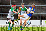 Kerry wing forward Colum Harty gets his shot in despite the close attention of Limerick's Seamus Hickey during their NHL Div 1B clash in Fitzgerald Stadium on Sunday