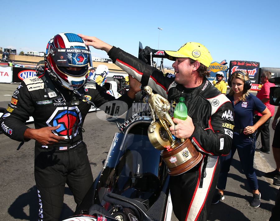 Jul 30, 2017; Sonoma, CA, USA; NHRA top fuel driver Steve Torrence (right) celebrates with Antron Brown after winning the Sonoma Nationals at Sonoma Raceway. Mandatory Credit: Mark J. Rebilas-USA TODAY Sports