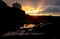 "22/10/19<br /> <br /> The sun sets behind the Old Coastguards House in Appledore, on the North Devon coast, casting stunning Crepuscular rays into the sky above the Taw and Torridge Estuary. Also known as ""God rays"" these sunbeams originate when the sun is below the horizon, during twilight hours. Crepuscular rays usually appear orange because the path through the atmosphere at sunrise and sunset passes through up to 40 times as much air as rays from a high midday sun.<br /> <br /> All Rights Reserved: F Stop Press Ltd.  <br /> +44 (0)7765 242650 www.fstoppress.com"