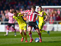 Lincoln City's Shay McCartan is fouled by Cheltenham Town's Jordan Tillson<br /> <br /> Photographer Andrew Vaughan/CameraSport<br /> <br /> The EFL Sky Bet League Two - Lincoln City v Cheltenham Town - Saturday 13th April 2019 - Sincil Bank - Lincoln<br /> <br /> World Copyright &copy; 2019 CameraSport. All rights reserved. 43 Linden Ave. Countesthorpe. Leicester. England. LE8 5PG - Tel: +44 (0) 116 277 4147 - admin@camerasport.com - www.camerasport.com