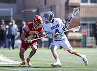 Washington, DC - March 31, 2018: Georgetown Hoyas Daniel Bucaro (4) is being defended by Denver Pioneers Dylan Gaines (41) during game between Denver and Georgetown at  Cooper Field in Washington, DC.   (Photo by Elliott Brown/Media Images International)