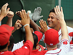 Outfielder Ronald Bermudez (22) of the Greenville Drive smiles after hitting a two-run home run in the first inning of a game against the Savannah Sand Gnats on July 2, 2010, at Fluor Field at the West End in Greenville, S.C. Photo by: Tom Priddy/MiLB.com