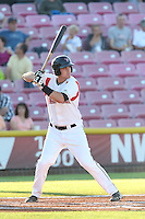 Jonathan Jones #23 of the Salem-Keizer Volcanoes bats against the Spokane Indians at Volcanoes Stadium on July 26, 2014 in Keizer, Oregon. Spokane defeated Salem Keizer, 4-1. (Larry Goren/Four Seam Images)