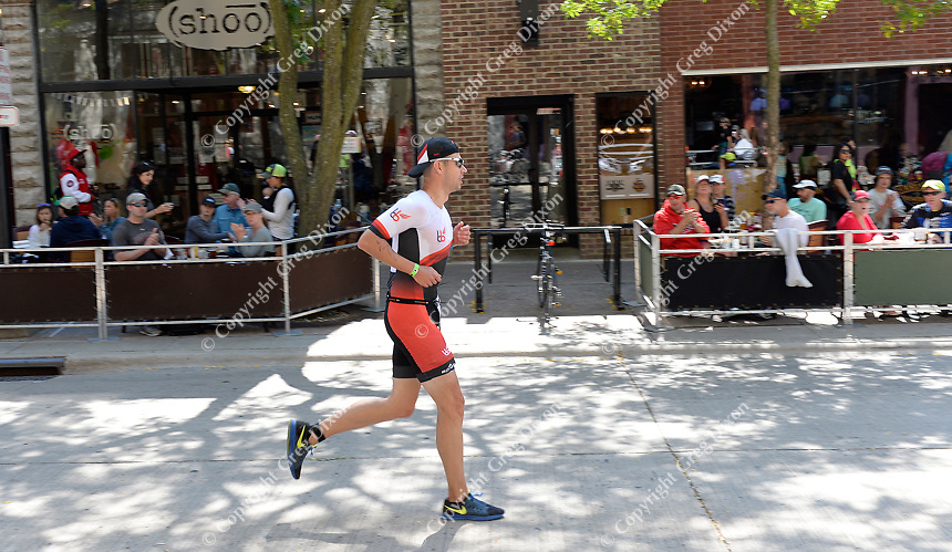Athletes run down State Street during the 2017 IRONMAN Wisconsin on Sunday, September 10 in Madison