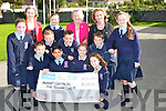 "CHEQUE: Coiste Glas of Ardfert NS accepting the €5,000 cheque from Enna Ní Lamhna ""Mooney Goes Whild"" RTE Radio 1, on Tuesday morning with Betty Stack (principal) and Marie O'Connell(teacher) the cheque was presented to te school for their acheivement over the past couple of years. Front l-r: Cian McDonagh, aaron Malik, Sarah Egan and Clodagh O'Loughlin. Middle row l-r: Ali Cavanagh, Padraig O'Sullivan, Christopher Egan and Billy Daly. Back l-r: Marie O'Connell (teacher), Mairead Kearney, Enna Ní Lamhna, Betty Stack (principal) and Ciara McCarthy."