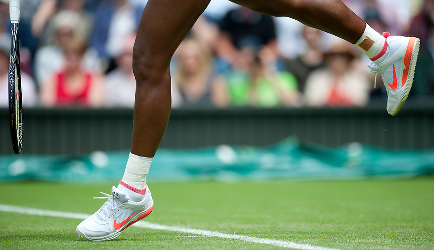 Serena Williams (USA) [1] in action during her victory over Mandy Minella (LUX) in their Ladies' Singles First Round match today - Serena Williams (USA) [1] def Mandy Minella (LUX) 6-1 6-3 <br /> <br />  (Photo by Stephen White/CameraSport) <br /> <br /> Tennis - Wimbledon Lawn Tennis Championships - Day 2 Tuesday 25th June 2013 -  All England Lawn Tennis and Croquet Club - Wimbledon - London - England<br /> <br /> &copy; CameraSport - 43 Linden Ave. Countesthorpe. Leicester. England. LE8 5PG - Tel: +44 (0) 116 277 4147 - admin@camerasport.com - www.camerasport.com.