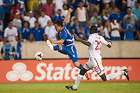 El Salvador forward Rodolfo Zelaya (11) is marked by Trinidad and Tobago defender Seon Power (20) during a CONCACAF Gold Cup group B match at Red Bull Arena in Harrison, NJ, on July 8, 2013.