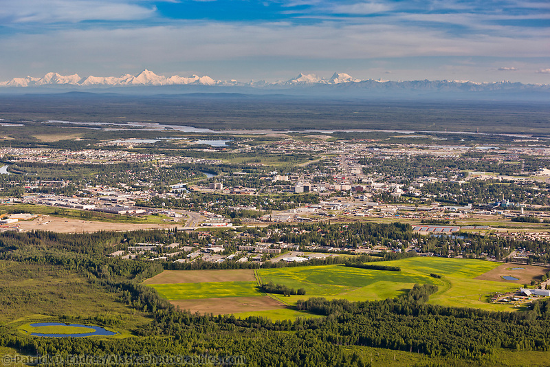 Aerial of the city of Fairbanks and the distant Alaska range mountains, Creamer's field migratory waterfowl refuge in the foreground.
