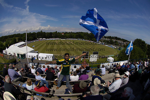 Scotland V Pakistan - 1st ever One Day International played by Scotland, at Grange CC, Raeburn Place, Edinburgh - Akbar Ali from Cambuslang, of Pakistani origin, but happily supporting Scotland on top of the Grange clubhouse.... Picture by Donald MacLeod 27.6.06