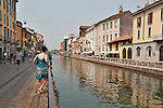 Canal in Milan, Italy in the Navigli area which has a bohemian vibe. Milan, Italy originally had five major canals which were moved covered in the 1960's and today leaves a small portion of two canals lined with apartments, restaurants, and stores