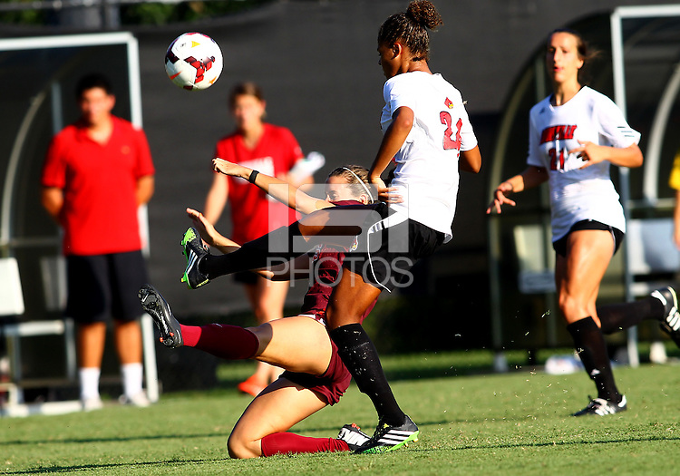 WINSTON-SALEM, NORTH CAROLINA - August 30, 2013:<br />  Rachel Melhado (24) of Louisville Universitykicks the ball away from Katie Yensen (3) of Virginia Tech during a match at the Wake Forest Invitational tournament at Wake Forest University on August 30. The game ended in a 1-1 tie.