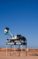 A blower (truck used to extract dirt from underground opal mines) welcomes visitors to the outback town of Coober Pedy - the opal capital of Australia.  Coober Pedy, South Australia, AUSTRALIA.
