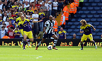 Pictured: Nicolas Anelka of West Brom (C) against Jonjo Shelvey (L) and Jose Canas of Swansea (R). Sunday 01 September 2013<br />