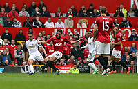 Pictured: (L-R) Neil Taylor, Robin van Persie, Jonathan de Guzman, Nemanja Vidic.<br />