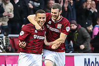 Rod McDonald of Northampton Town (left) celebrates scoring his team's third goal against Morecambe to make it 3-0 with Zander Diamond of Northampton Town (right) during the Sky Bet League 2 match between Northampton Town and Morecambe at Sixfields Stadium, Northampton, England on 23 January 2016. Photo by David Horn / PRiME Media Images.
