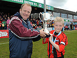 Thomas O'Connell of Drogheda Town FC under 11 recieves the match trophy at the Drogheda and District schoolboys cup finals in Hunky Dorys park. Photo: Colin Bell/pressphotos.ie