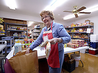 NWA Democrat-Gazette/BEN GOFF &bull; @NWABENGOFF<br /> Caroline Searls bags food for a family on Friday Aug. 14, 2015 while volunteering with the Shepherd's Food Pantry program at Bella Vista Lutheran Church. The program, which distributes bags of food to members of the community each Friday, has grown from helping feed 1346 people in 2010, it's first year, to helping 6837 in 2014, according to a press release. An expansion and remodeling project at the church is nearing completion and has doubled the space available to the food pantry program.